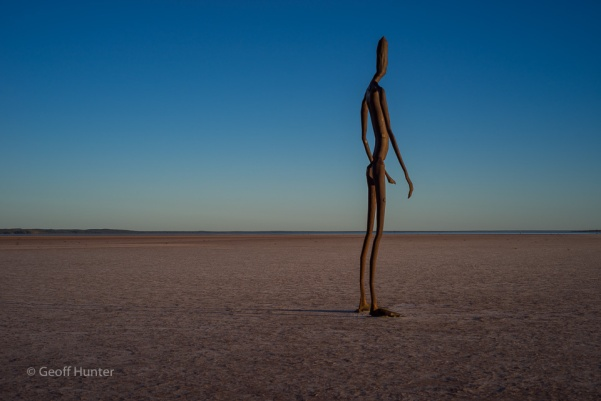 statue on Lake Ballard at Sunrise