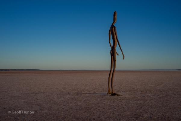 statue on Lake Ballard at Sunrise